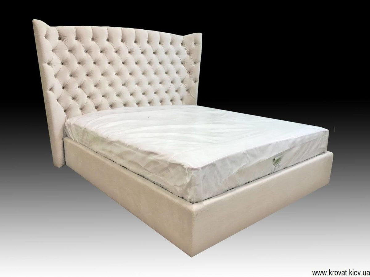 winged ottoman storage bed