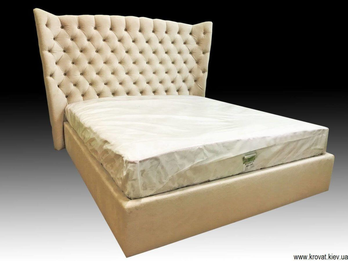upholstered winged bed