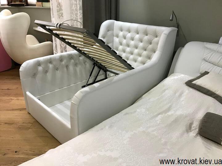 дитяче ліжко з бортиками з підйомним механізмом
