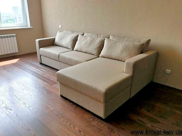 кутовий диван-ліжко у вітальню