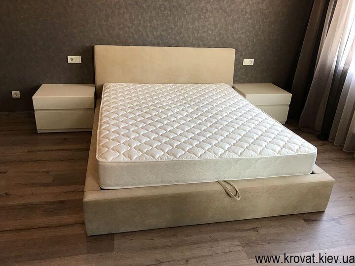 приліжкові тумбочки в інтер'єрі спальні