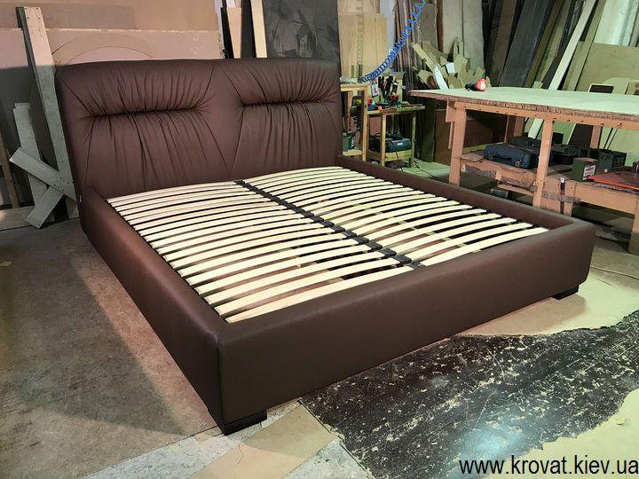 ліжко з м'яким узголів'ям і ящиком