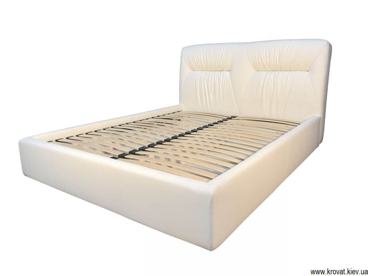 біле шкіряне ліжко