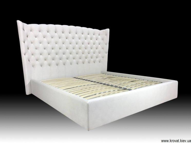 ліжко з високим м'яким узголів'ям на замовлення