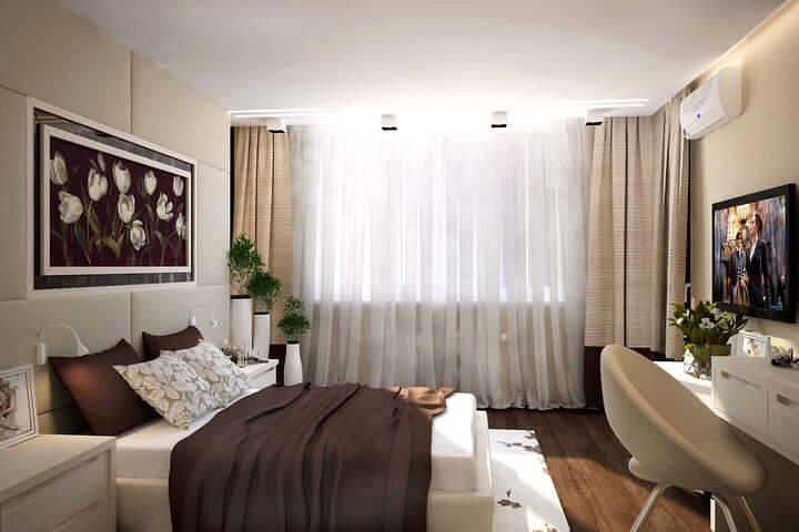 кровать с подсветкой бра на изголовье в спальне
