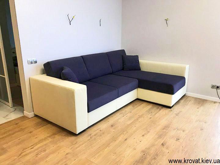угловой диван кровать в интерьере комнаты